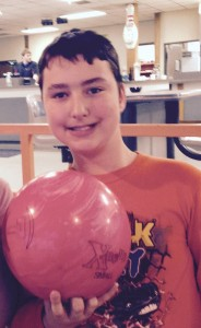 A 12 year old having fun bowling with the Cape Evening Optimist Club